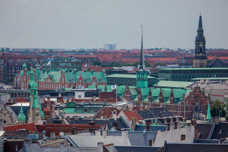 Copenhagen, Denmark - July 29, 2015: Copenhagen, the city of spires. Cityscape with Borsen Building or Stock Exchange. Editorial