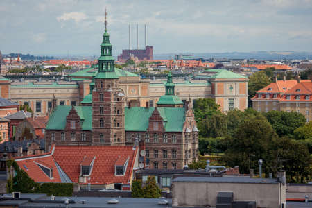 Copenhagen, Denmark - July 29, 2015: Copenhagen, the city of spires. Cityscape with Rosenborg Castle and Svanemolle Power Plant in the distance.