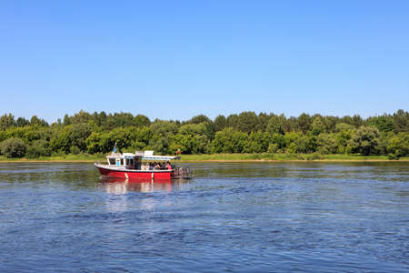Zapyskis, Lithuania - June 9, 2018: Passenger cutter crosses the river Nemunas near Zapyskis and Vilkija, Lithuania Editorial