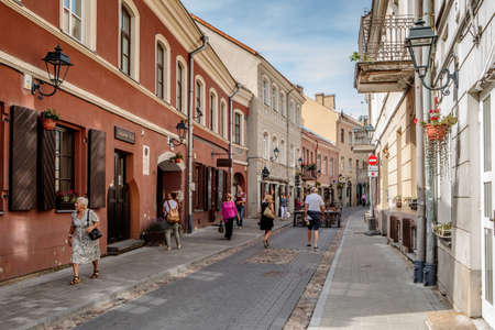 Vilnius, Lithuania - August 19, 2018: People walk along Saviciaus street, picturesque street of Vilnius old town. Editorial