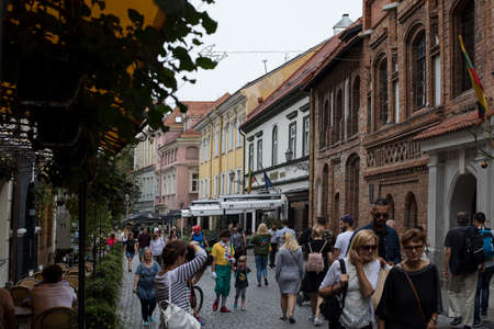 Vilnius, Lithuania - September 2, 2018: Lots of people walk along Pilies street, one of the main streets of Vilnius old town. Editorial