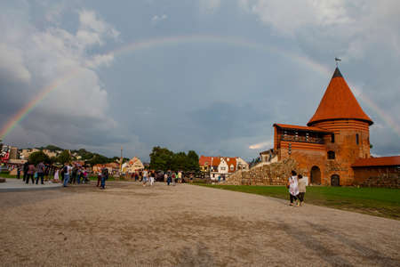 Kaunas, Lithuania - July 14, 2018: Rainbow over Kaunas Castle, built during the mid-14th century, in the Gothic style.