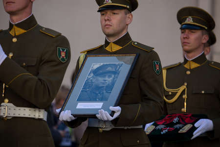 Vilnius, Lithuania - October 6, 2018: Soldiers carry the portrait of Brigadier General Adolfas Ramanauskas-Vanagas, prominent leader of the Lithuanian Freedom Fighters, during his state funeral ceremony.