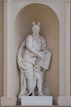 Statue of prophet Moses on the wall of Vilnius Cathedral, Lithuania