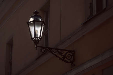Old street lamp on the wall of Vilnius old town, Lithuania Stock Photo