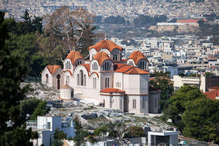 Athens, Greece - October 24, 2018: The aerial view of Athens from Acropolis hill with the The St Marina church atop Nymphs' Hill in Thissio.