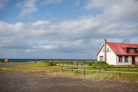 Dramatic summer scene on Icelandic coast with typical house. Iceland, Europe.