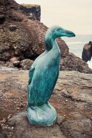 Reykjanesviti, Iceland - September 6, 2018: A bronze sculpture at the Valahnukur cliffs on the Reykjanes Peninsula commemorates the now-extinct Great Auk. Editorial