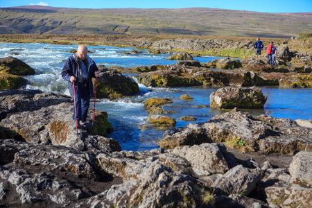 Godafoss, Iceland - September 2, 2018: Tourist hikes to Godafoss waterfall in Iceland in September.