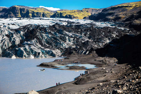 Solheimajokull, Iceland - September 5, 2018: Solheimajokull Glacier in southern Iceland. It is melting rapidly due to warming temperatures caused by climate change.