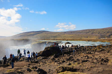 Godafoss, Iceland - September 2, 2018: Godafoss waterfall at sunny late summer day, spectacular landscape of Iceland iconic place. Skjalfandafljot river, North of Iceland Editorial