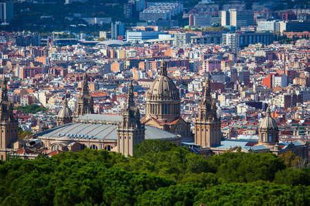 Panoramic cityscape of Barcelona (Spain) with Catalunya National Museum of Art (MNAC) from the Montjuic mount in a sunny day. Aerial view. Editorial