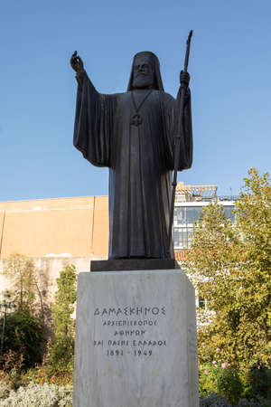 Athens, Greece - October 25, 2018: Statue of Archbishop Damaskinos who was Archbishop of Athens during World War II in the  Mitropolis Square in front of the Metropolitan Cathedral.