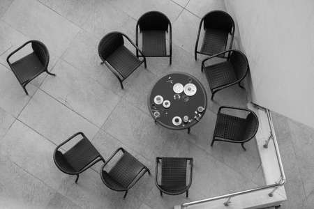 Table with chairs from above. Teamwork concept. One against the crowd. One against all.