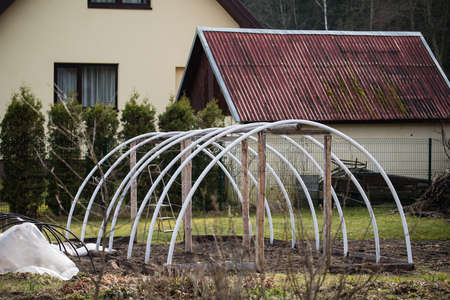 Early spring works in the garden. Building of the greenhouse for the vegetable growing