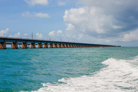 Piling support of abandoned and damaged Old Seven Mile Bridge railroad with landscape view in Florida Keys in Atlantic ocean near Overseas Highway