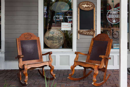 Key West, FL, USA - October 6, 2016: Rocking chairs in front of  the bar in Key West.