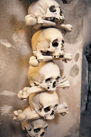 Kutna Hora, Czech Republic - June 29, 2019: Human skulls and bones used as decoration in the Sedlec Ossuary, Czech Republic.