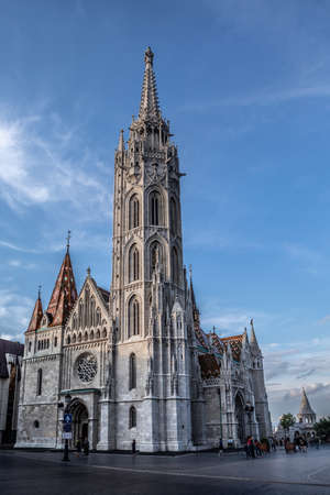 Budapest, Hungary - July 12, 2019: Matthias Church in Budapest, Hungary, located in front of the Fisherman's Bastion at the heart of Buda's Castle District.