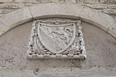 Coat of arms of city Trogir with a lion on the shield.