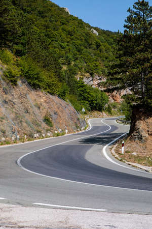 Curved road in the mountains of Croatia, serpentine driveway 版權商用圖片