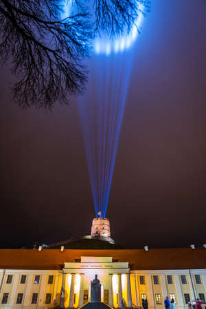 Vilnius, Lithuania - January 26, 2020: National museum and Gediminas castle illuminated for 697  city birthday celebrations during Vilnius Festival of Light 2020.