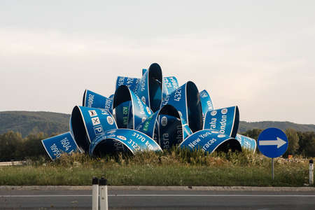 """Stockerau, Austria - August 26, 2017: Roundabout art in Austria, sculpture """"Here after here after here"""" by Indian artist Jitish Kallat, 2012. Editorial"""