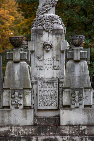 Kaunas, Lithuania - October 5, 2019: Dead for the Fatherland monument in Serenity park, sculptor S. Stanisauskas, 1930. Text: Dead for the Fatherland. No one has bigger love than the one who dies for his friends.