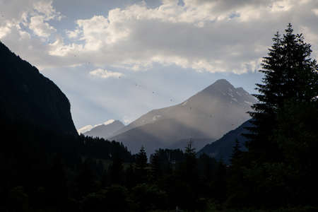 Alpine landscape in the misty morning with a silhouette of  the slopes of Alps in Hohe Tauern National Park, Austria