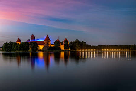 Trakai, Lithuania - July 14, 2020: Trakai Castle after sunset in the lake Galve. Trakai Castle is one of major tourist attractions of Lithuania. Editoriali