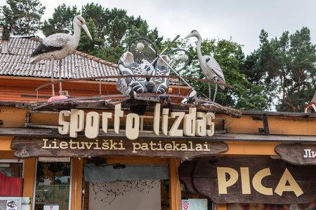 Palanga, Lithuania - July 11, 2020: The signboard of popular restaurant Sporto lizdas on Basanaviciaus street in Palanga resort, Lithuania.