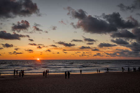 Palanga, Lithuania - July 12, 2020: Sunset in the Baltic sea with silhouettes of people standing on the beach, Palanga, Lithuania Editoriali
