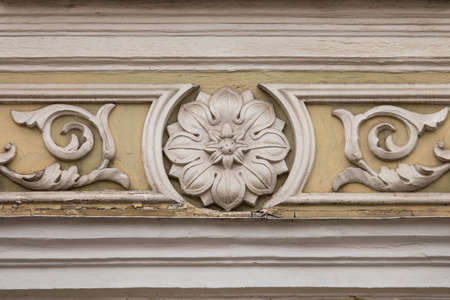 Floral stucco moulding rosette on the wall of some Vilnius oldtown buildings