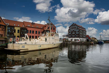 Klaipeda, Lithuania - July 10, 2020: Ships and boats at embankment on Dane River in old town of Klaipeda, Lithuania.