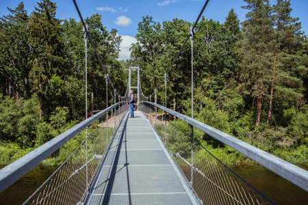 Hanging bridge across the Sventoji River in Anyksciai Regional Park, Lithuania