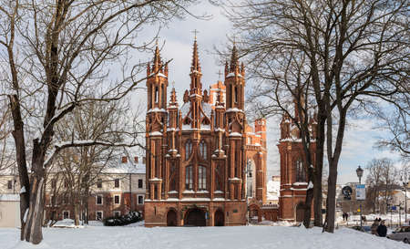 Vilnius, Lithuania - February 16, 2021: Facade of the Church of St. Anne, a prominent landmark in the Old Town of Vilnius in winter.