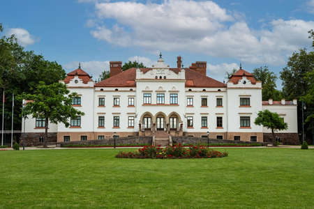 Rokiskis, Lithuania - July 16, 2017: Front view of Rokiskis Manor in Rokiskis, Lithuania. This building was built in 1801 in Neoclassical style, now here works Regional museum. Redakční