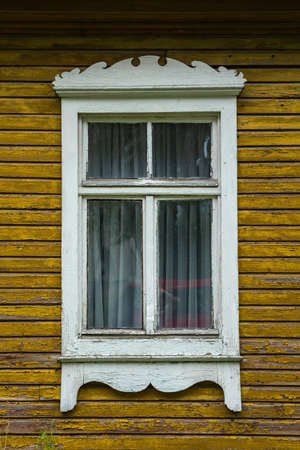Traditional lithuanian house detail - window with traditional ornaments