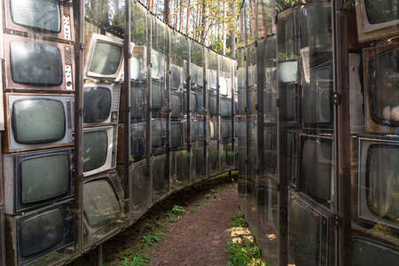 """Vilnius, Lithuania - August 31, 2019: Sculpture LNK Infotree by Gintaras Karosas made from old TV sets in the open air museum of the Centre of Europe """"Europos Parkas"""" (Park of Europe). Sajtókép"""
