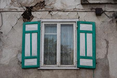 Vintage window with shutters in Kaunas, Vilijampole district. Lithuania Zdjęcie Seryjne