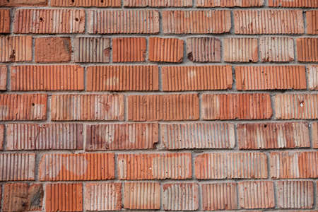 Old building wall made from red bricks with ridges