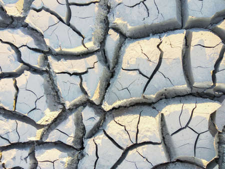 dry soil texture background with large cracks Фото со стока