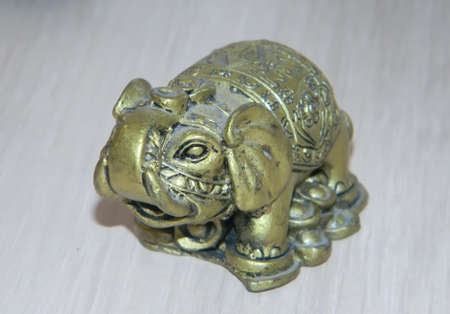 Bronze elephant figurine with a raised trunk isolated