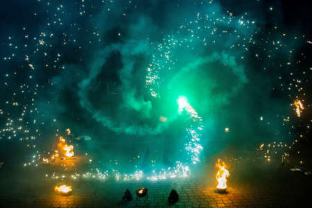 Fire show of smoke, steam and bright light effects. Dance with fire, amateur performance