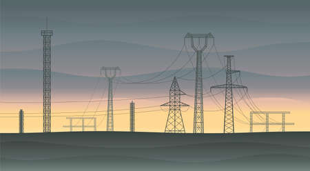 Landscape with electricity pylons and powerlines at sunset.