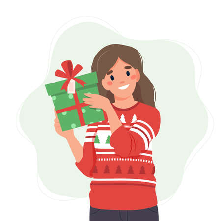 Woman in christmas sweater holding a gift box. Vector illustration in flat style