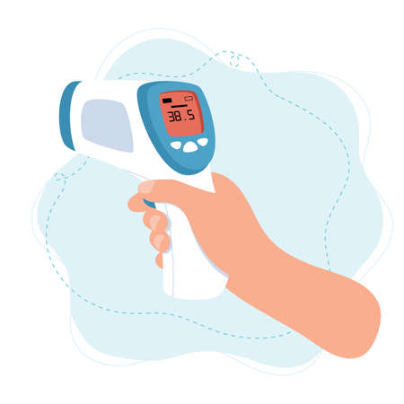 Body temperature check, hand holding infrared thermometer.