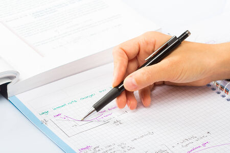 financial statement: womans hands a pen, financial statement accounting