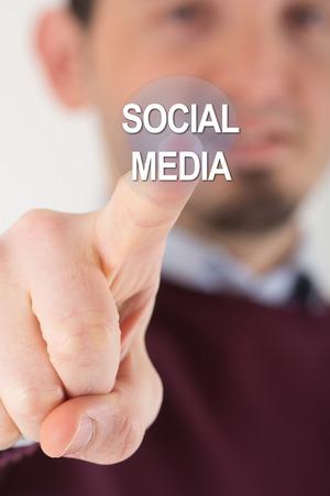 Man hand pressing social media icon photo