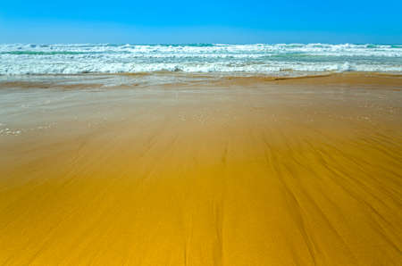 oceanic: Beautiful oceanic beach with yellow sand and blue sky